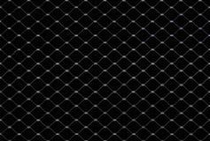 Gecombineerd metaalnet op een zwarte achtergrond als naadloze textuur stock afbeeldingen