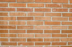 Geconcentreerde textuur van oranje stevige bakstenen muur Stock Foto