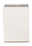 Gecontroleerd die notitieboekje op wit wordt geïsoleerd stock afbeeldingen