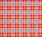 Gecontroleerd patroon in rode tonen Stock Foto's