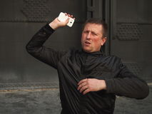 Ged rid of it!. Man throwing away a smart phone Stock Photos