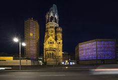 Gedaechtniskirche at Kudamm in Berlin. BERLIN, GERMANY - MAY 2, 2015: The Kurfurstendamm (colloquially Ku damm), one of the most famous avenues in Berlin. The Stock Images