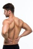 Gedeeltelijk desaturated beeld van gespannen mannelijke rug stock foto's