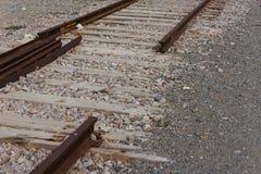Gedemonteerde spoorweg op het gebied royalty-vrije stock foto