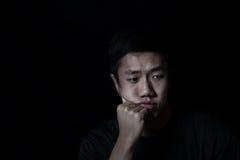 Gedeprimeerde jonge mens Stock Afbeelding