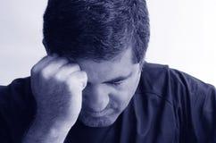 Gedeprimeerde mens Stock Foto