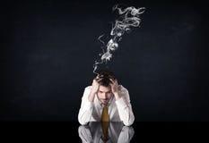 Gedeprimeerde zakenman met rokend hoofd stock foto's