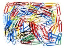 Gedesorganiseerde multicolored paperclips Stock Afbeeldingen