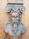 Gedetailleerd houten mensenornament stock foto