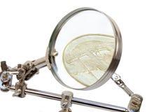 Gedetailleerde analyse van munten stock afbeelding
