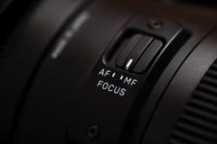 Gedetailleerde foto van zwarte lens met knopen Royalty-vrije Stock Foto's