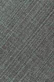Gedetailleerde textuur van donkere denimdoek Stock Afbeeldingen
