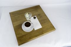 Gediend met een kop van koffie en suiker stock afbeelding
