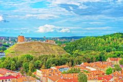 Gediminas Tower with hill and roof tops of Vilnius. Gediminas Tower with the hill and roof tops of the old town center of Vilnius, Lithuania stock image