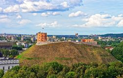 Gediminas Tower on the hill and rooftops of Vilnius. Gediminas Tower on the hill and rooftops of the old town center of Vilnius, Lithuania stock photography