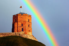 Gediminas tower in Vilnius, Lithuania against rainbow in the sky.  stock photo