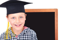 Gediplomeerde jongen in GLB met bord op achtergrond Stock Foto