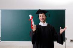 Gediplomeerde student voor groene raad stock afbeelding