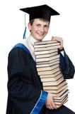 Gediplomeerde in toga met boeken stock fotografie