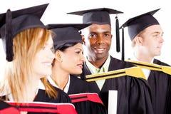 Gediplomeerden bij graduatie royalty-vrije stock afbeeldingen