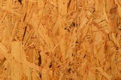 Gedrängte Holzverkleidung (OSB) für das Errichten Nahtlose Tileable Beschaffenheit Stockfotografie