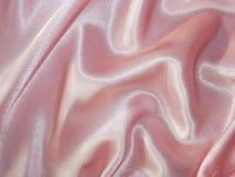Gedrapeerd roze satijn - stoffenachtergrond Royalty-vrije Stock Afbeelding