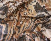 Gedrapeerde bruine multicolored stof met lovertjes Royalty-vrije Stock Foto
