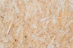 gedrukt zaagsel in de raad Houten geweven achtergrond achtergrond van gedrukt beige houten zaagsel royalty-vrije stock afbeelding
