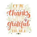 Geef dank met een dankbaar hart - Thanksgiving day het van letters voorzien kalligrafieuitdrukking met bladeren en harten De herf stock illustratie