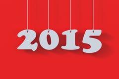 Geef van 2015 Witboekorigami kaart op rode achtergrond terug Royalty-vrije Stock Foto