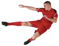 Geeigneter spielender und tretender Fußballspieler lizenzfreies stockfoto