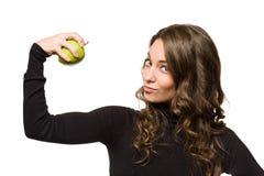 Geeignetes junges brunett mit Apfel. Stockbilder