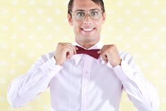 Geek Adjusting Bow Tie Stock Image