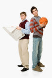Geek and basketball player Royalty Free Stock Photo