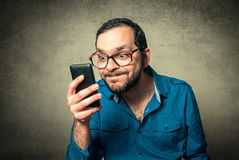 Geek with beard and phone royalty free stock photography