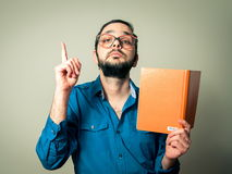 Geek with  beard reading Stock Image