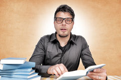 Geek with books Stock Images