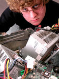 Geek with computer internals Royalty Free Stock Image