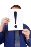 Geek is holding exclamation mark Stock Photo