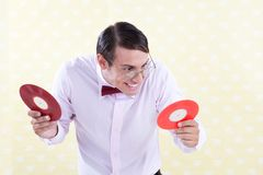 Geek with LP Record. Excited nerdy geek with vinyl record Royalty Free Stock Photos