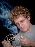 Geek met Rokende Draden Royalty-vrije Stock Afbeeldingen