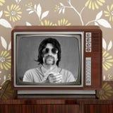 Geek mustache tv presenter in retro tv. Geek mustache tv presenter in retro wood television vintage wallpaper Royalty Free Stock Photo