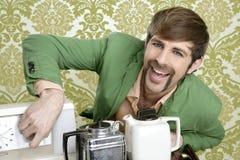 Geek retro man drinking tea coffee vintage teapot Stock Photos