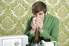 Geek retro man drinking tea coffee vintage teapot Stock Photography