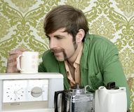 Geek retro man drinking tea coffee vintage teapot Royalty Free Stock Image
