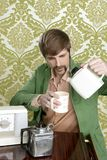 Geek retro man drinking tea coffee vintage teapot Royalty Free Stock Photography