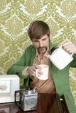 Geek retro man drinking tea coffee vintage teapot Royalty Free Stock Photography