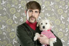 Geek retro man holding dog silly on wallpaper. Geek retro man holding dog silly couple on wallpaper Royalty Free Stock Image