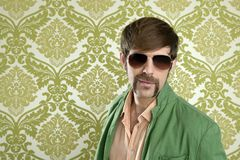 Geek retro salesperson man funny mustache. Sunglasses in green wallpaper Stock Photos