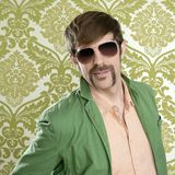 Geek retro salesperson man funny mustache. Sunglasses in green wallpaper royalty free stock photography